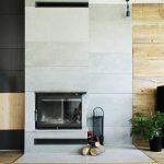 Płyty z betonu wokół kominka w salonie